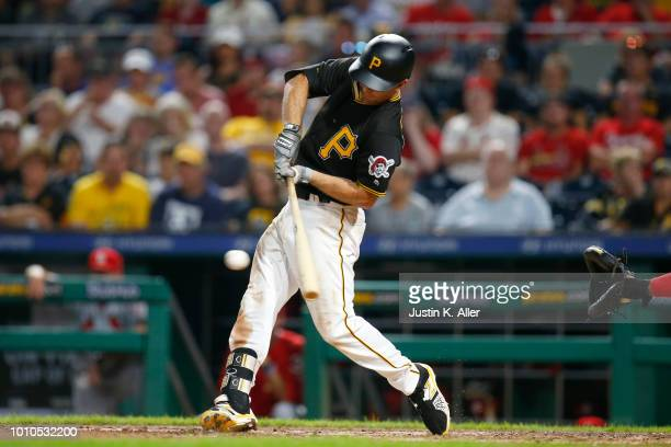 Adam Frazier of the Pittsburgh Pirates hits an RBI single in the eighth inning against the St Louis Cardinals at PNC Park on August 3 2018 in...