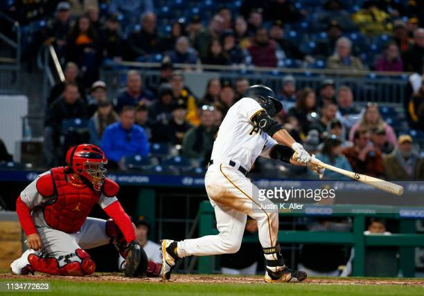 Adam Frazier of the Pittsburgh Pirates hits an RBI single in the second inning against the St Louis Cardinals at PNC Park on April 3 2019 in...