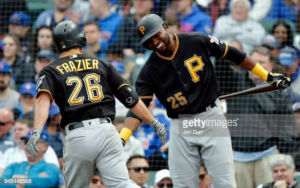 Adam Frazier of the Pittsburgh Pirates is congratulated by Gregory Polanco after hitting a home run against the Chicago Cubs during the fifth inning...