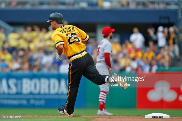 Adam Frazier of the Pittsburgh Pirates rounds second after hitting a home run in the seventh inning against the St Louis Cardinals at PNC Park on...