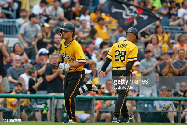 Adam Frazier of the Pittsburgh Pirates rounds third after hitting a home run in the seventh inning against the St Louis Cardinals at PNC Park on...