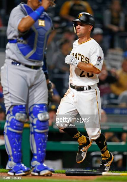 Adam Frazier of the Pittsburgh Pirates scores on a RBI single in the third inning against the Kansas City Royals during interleague play at PNC Park...