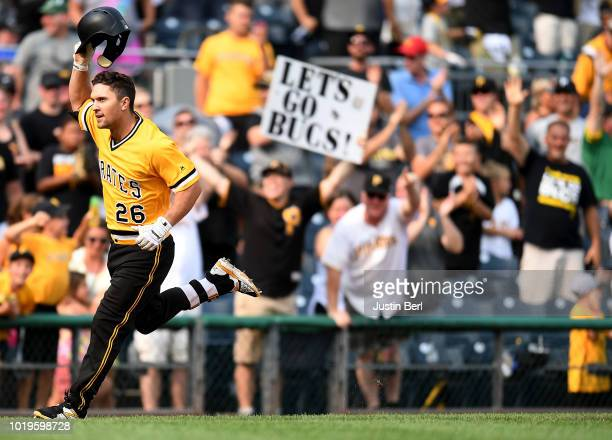 Adam Frazier of the Pittsburgh Pirates takes off his batting helmet as he rounds the bases after hitting a walk off home run to give the Pittsburgh...