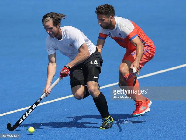 Adam Froese of Canada is put under pressure by Valentin Verga of the Netherlands during the Hero Hockey World League SemiFinal match between...