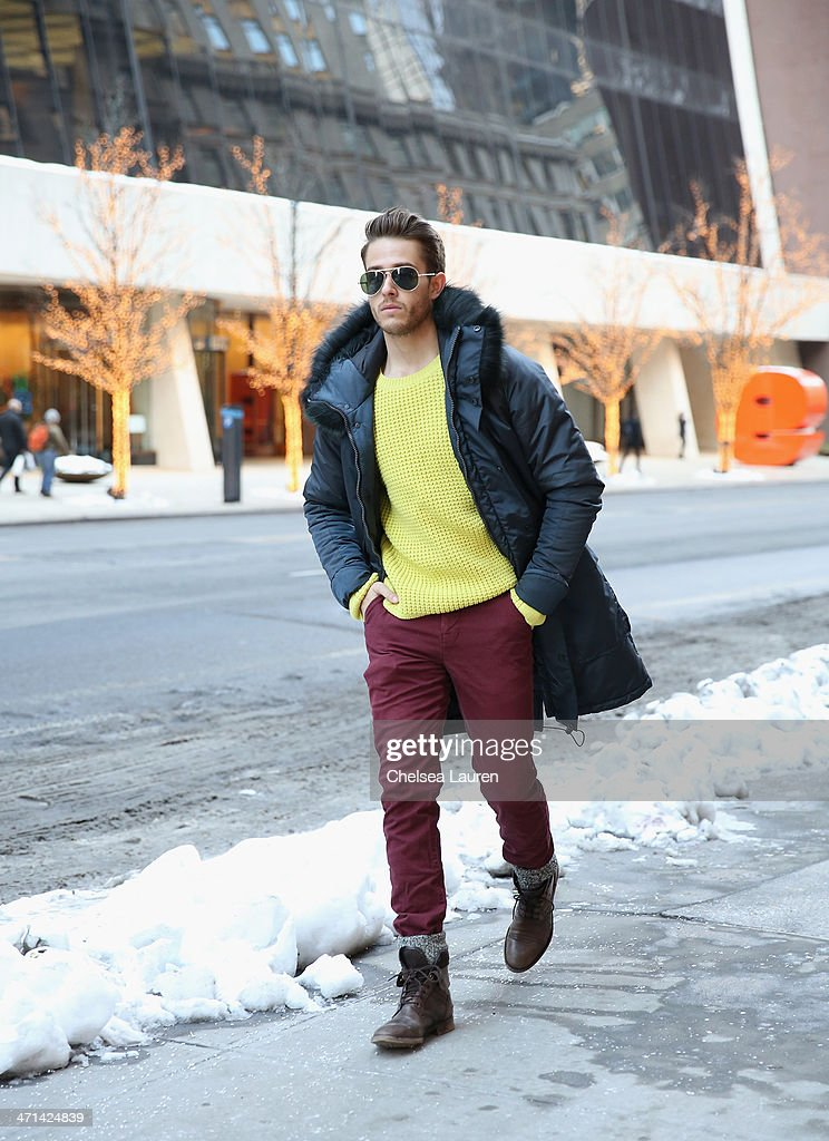 Adam Gallagher, menswear blogger of iamgalla.com seen wearing a parka and sweater by Black Sail by Nautica Fall 2014, with his own Hawkings McGill jeans, Zara shoes, and vintage sunglasses on the streets of midtown Manhattan during Mercedes-Benz Fashion Week Fall 2014 on February 10, 2014 in New York City.