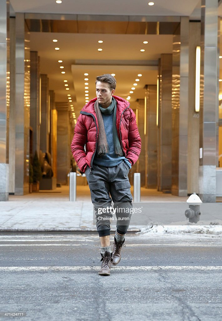 Adam Gallagher, menswear blogger of iamgalla.com seen wearing a red jacket, blue sweater, and pants by Black Sail by Nautica Fall 2014, with his own scarf from Urban Outfitters, and Zara shoes, on the streets of midtown Manhattan during Mercedes-Benz Fashion Week Fall 2014 on February 10, 2014 in New York City.