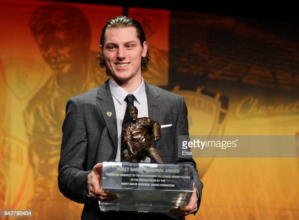 Adam Gaudette of Northeastern University and the Vancouver Canucks poses with the 2018 Hobey Baker Memorial Award during the ceremony on April 6 2018...