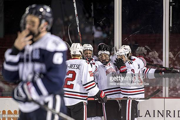 Adam Gaudette of Northeastern University reacts after scoring a goal during a Frozen Fenway game against University of New Hampshire at Fenway Park...