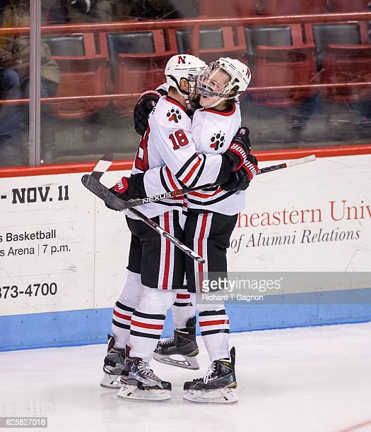 Adam Gaudette of the Northeastern Huskies celebrates his goal against the Minnesota Golden Gophers with his teammate John Stevens during NCAA hockey...