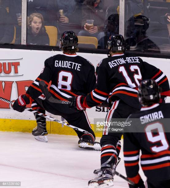 Adam Gaudette of the Northeastern Huskies celebrates his goal against the Harvard Crimson during NCAA hockey in the semifinals of the annual Beanpot...