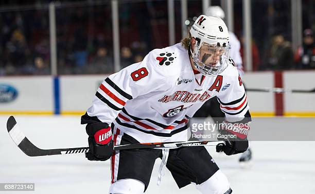 Adam Gaudette of the Northeastern Huskies skates against the New Hampshire Wildcats during NCAA hockey at Fenway Park during 'Frozen Fenway' on...