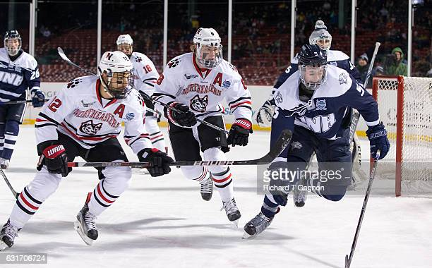 Adam Gaudette of the Northeastern Huskies skates into the corner against the New Hampshire Wildcats at Fenway Park during NCAA hockey during 'Frozen...
