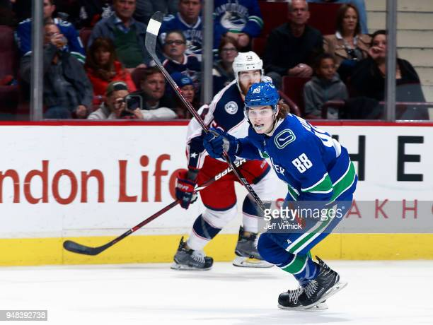 Adam Gaudette of the Vancouver Canucks and David Savard of the Columbus Blue Jackets skate up ice during their NHL game at Rogers Arena March 31 2018...