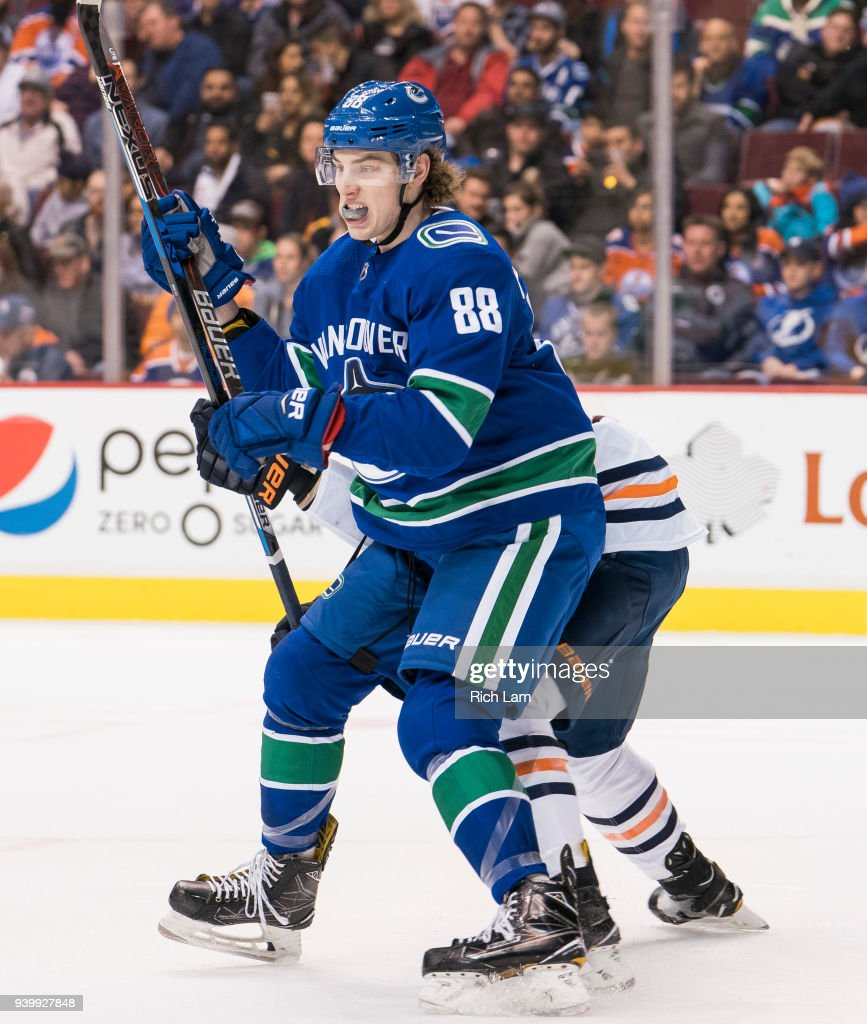 Adam Gaudette #88 of the Vancouver Canucks battles for position against the Edmonton Oilers in NHL action on March, 29, 2018 at Rogers Arena in Vancouver, British Columbia, Canada. This is Gaudette's first NHL game.