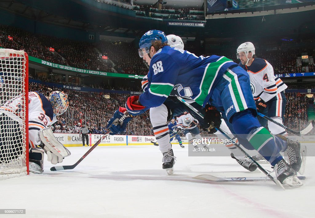 Adam Gaudette #88 of the Vancouver Canucks takes a shot against Cam Talbot #33 of the Edmonton Oilers during their NHL game at Rogers Arena March 29, 2018 in Vancouver, British Columbia, Canada. Vancouver won 3-1.