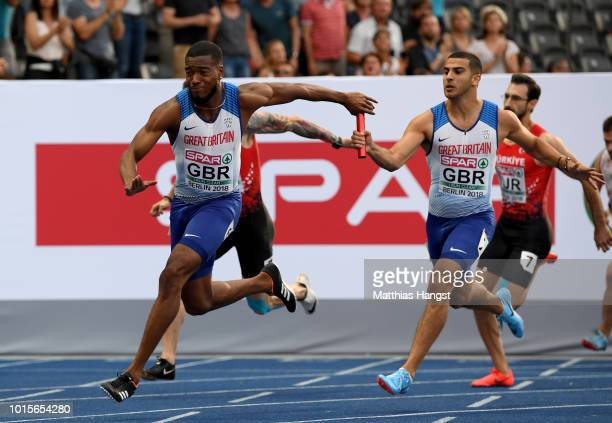 Adam Gemili and Nethaneel MitchellBlake of Great Britain exchange the baton in the Men's 4 x 100m Relay Round 1 Heat 1 during day six of the 24th...