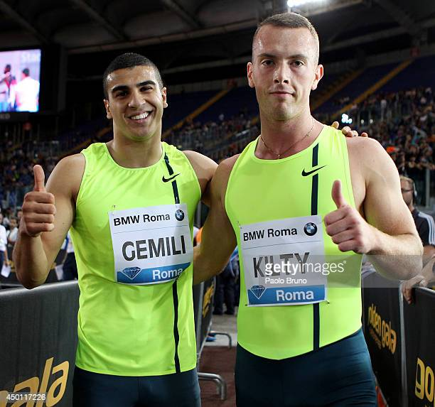 Adam Gemili and Richard Kilty of Great Britain give a thumbsup after the 100m men's race at the IAAF Golden Gala at Stadio Olimpico on June 5 2014 in...