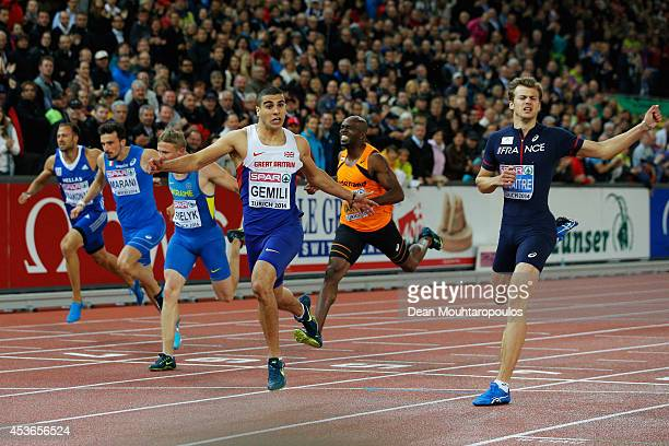 Adam Gemili of Great Britain and Northern Ireland celebrates winning gold ahead of silver medalist Christophe Lemaitre of France in the Men's 200...