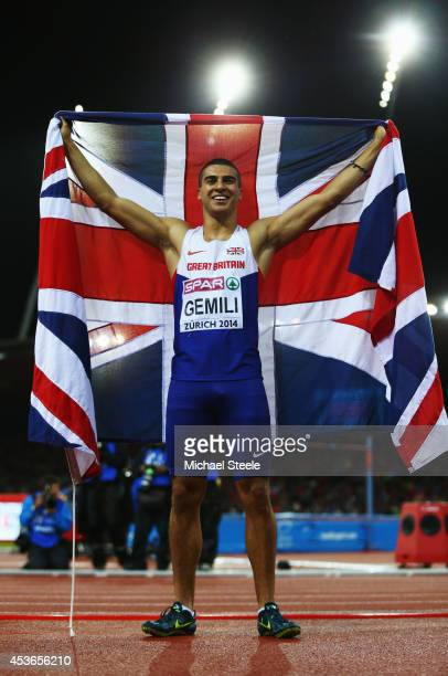Adam Gemili of Great Britain and Northern Ireland poses with a Union Jack as he celebrates winning gold in the Men's 200 metres final during day four...