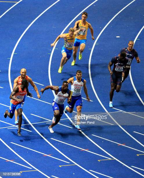 Adam Gemili of Great Britain passes the baton to Harry AiknesAryeetey of Great Britain in the Men's 4 x 100m Relay Final during day six of the 24th...