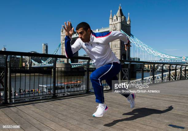 Adam Gemili of Great Britain poses for a photograph in front of Tower Bridge to announce that Athletics World Cup will showcase the first ever global...