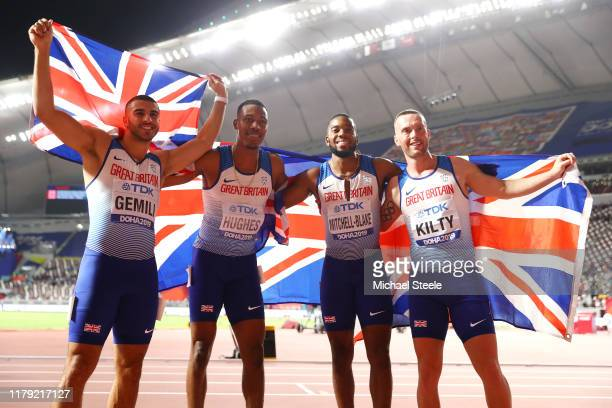 Adam Gemili Zharnel Hughes Richard Kilty and Nethaneel MitchellBlake of Great Britain celebrate silver in the Men's 4x100 Metres Relay during day...