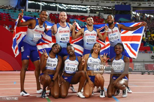 Adam Gemili Zharnel Hughes Richard Kilty and Nethaneel MitchellBlake of Great Britain celebrate silver in the Men's 4x100 Metres Relay with Asha...