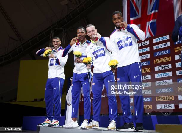 Adam Gemili Zharnel Hughes Richard Kilty and Nethaneel MitchellBlake of Great Britain silver pose during the medal ceremony for the Men's 4x100...