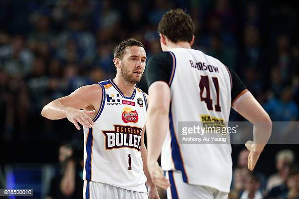 Adam Gibson and Cameron Bairstow of the Bullets celebrate a basket during the round 10 NBL match between the New Zealand Breakers and the Brisbane...