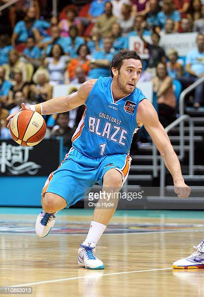 Adam Gibson dribbles the ball during the round 24 NBL match between the Gold Coast Blaze and the Adelaide 36ers at Gold Coast Convention and...
