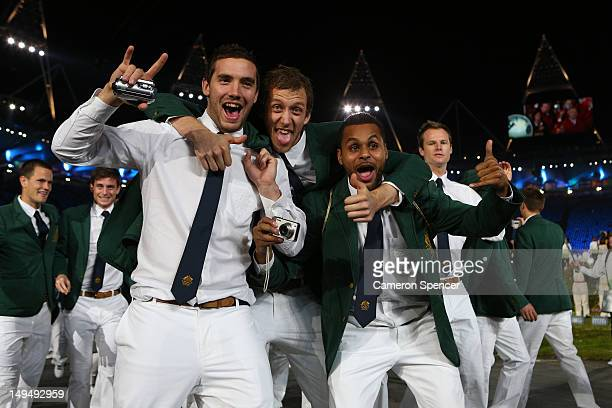 Adam Gibson, Joseph Ingles, and Patrick Mills of Australia walk the stadium during the Opening Ceremony of the London 2012 Olympic Games at the...