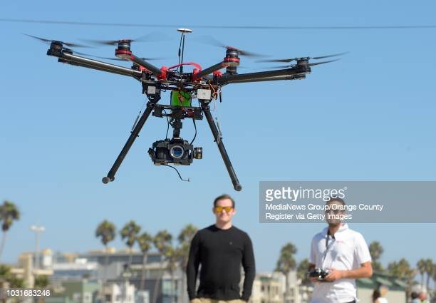 Adam Gibson, left, and Josh Sharfi fly an octocopter at a beach in Venice on Tuesday. The pair work at Ctrl Me in Venice. These guys are drone...