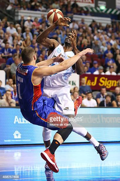 Adam Gibson of the 36ers blocks a shot by Ekene Ibekwe of the Breakers during the round four NBL match between the Adelaide 36ers and the New Zealand...