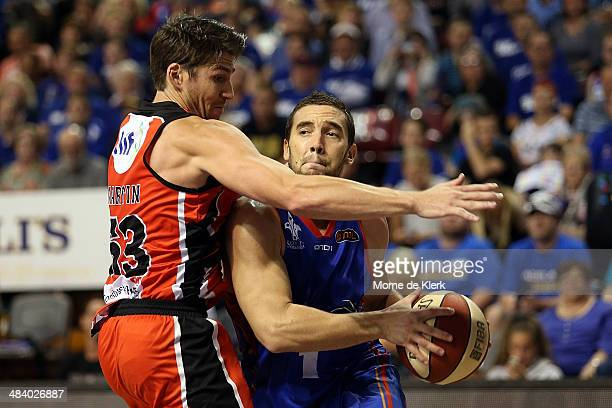 Adam Gibson of the 36ers is blocked by Damian Martin of the Wildcats during game two of the NBL Grand Final series between the Adelaide 36ers and the...