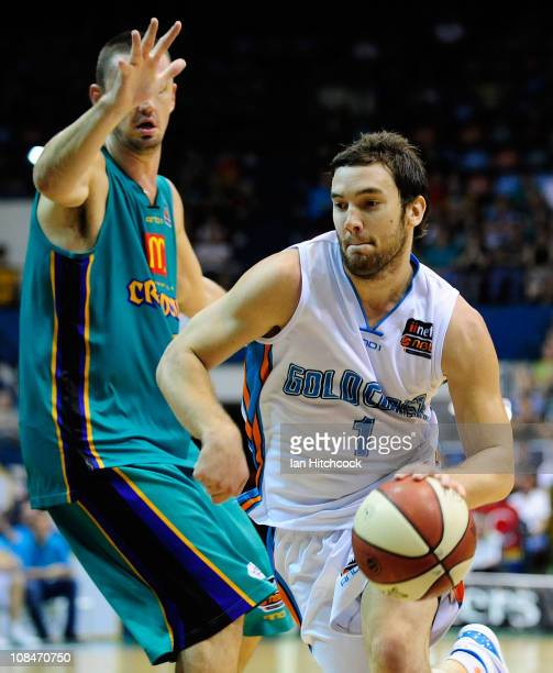 Adam Gibson of the Blaze drives past Russell Hinder of the Crocodiles during the round 16 NBL match between the Townsville Crocodiles and the Gold...