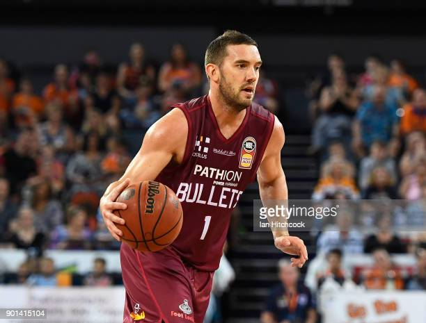 Adam Gibson of the Bullets dribbles the ball during the round 13 NBL match between the Cairns Taipans and the Brisbane Bullets at the Cairns...