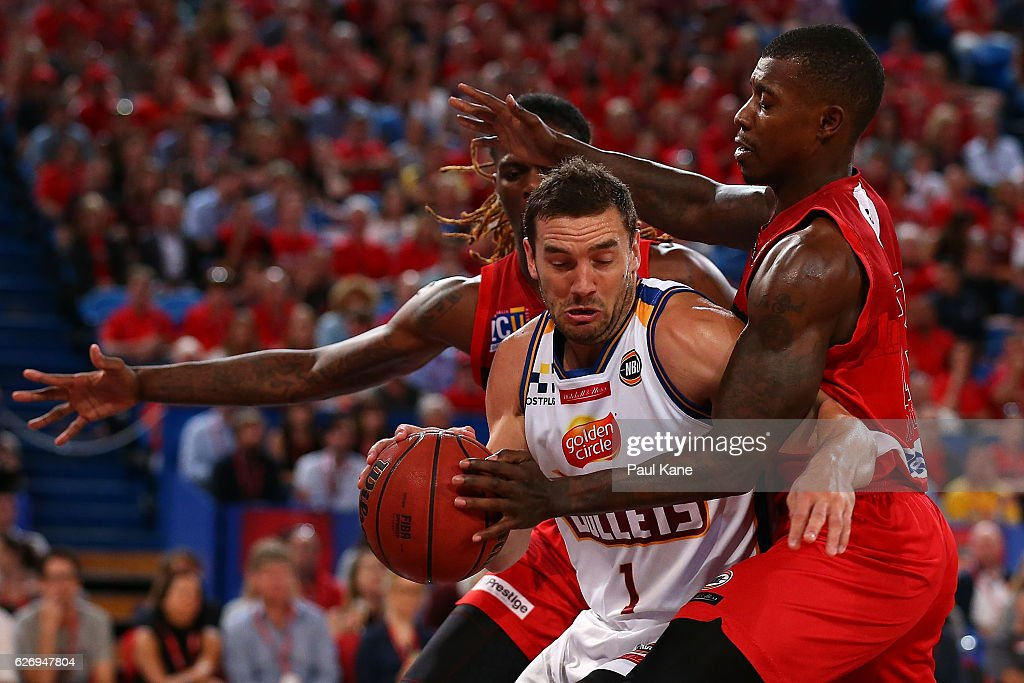 Adam Gibson of the Bullets gets doubled teamed by Jameel McKay and Casey Prather of the Wildcats during the round nine NBL match between the Perth Wildcats and the Brisbane Bullets at Perth Arena on December 1, 2016 in Perth, Australia.