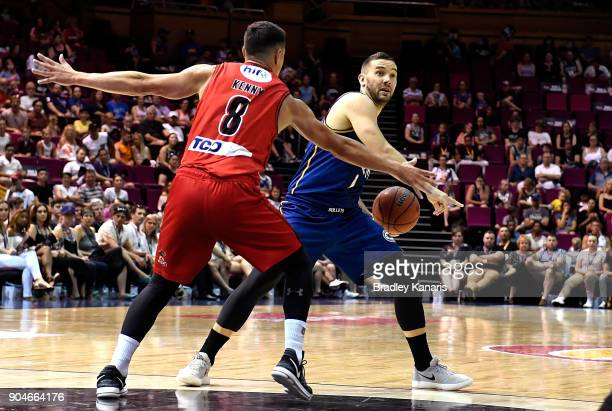 Adam Gibson of the Bullets looks to pass during the round 14 NBL match between the Brisbane Bullets and the Perth Glory at Brisbane Convention...