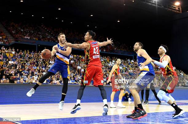 Adam Gibson of the Bullets passes the ball during the round 15 NBL match between the Brisbane Bullets and Melbourne United at Brisbane Entertainment...