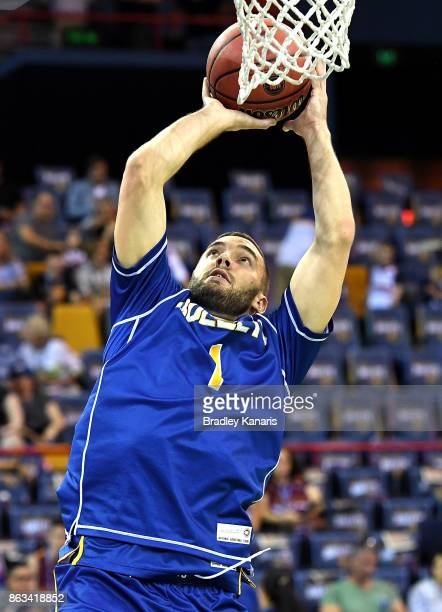 Adam Gibson of the Bullets shoots during the warmup before the round three NBL match between the Brisbane Bullets and the Cairns Taipans at Brisbane...