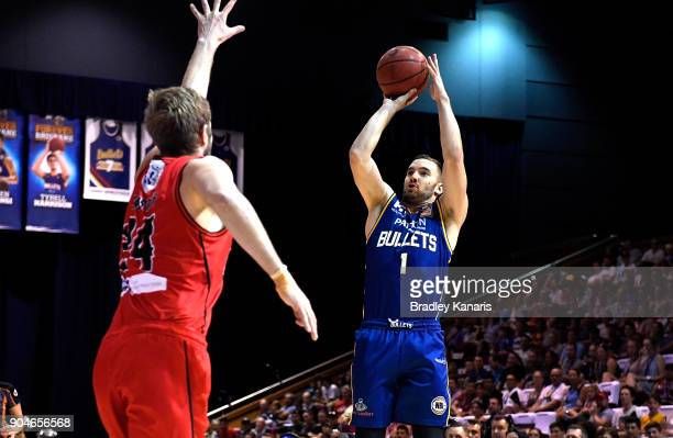 Adam Gibson of the Bullets shoots for basket during the round 14 NBL match between the Brisbane Bullets and the Perth Glory at Brisbane Convention...