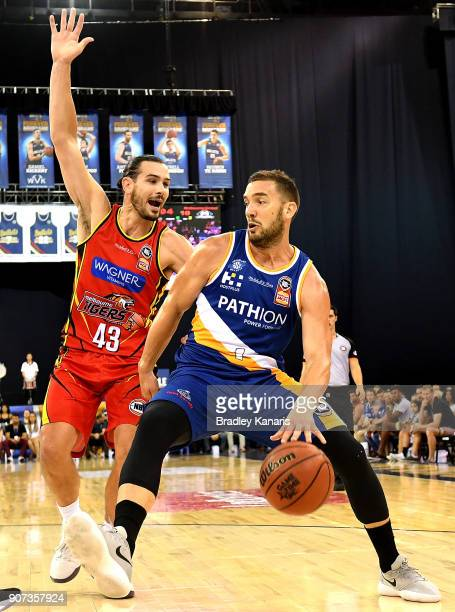 Adam Gibson of the Bullets takes on the defence of Chris Goulding of United during the round 15 NBL match between the Brisbane Bullets and Melbourne...