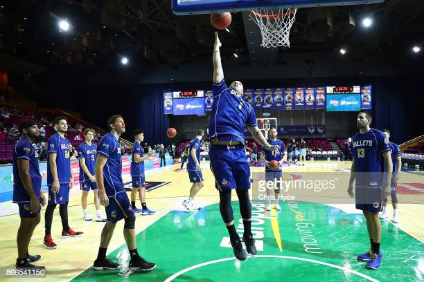Adam Gibson of the Bullets warms up before the round four NBL match between the Brisbane Bullets and the New Zealand Breakers at Brisbane Convention...