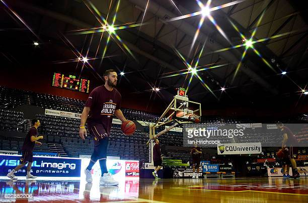 Adam Gibson of the Bullets warms up before the start of the round six NBL match between the Cairns Taipans and the Brisbane Bullets at the Cairns...