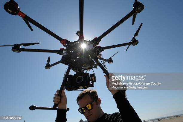 Adam Gibson, with an octocopter at a beach in Venice on Tuesday. The pair work at Ctrl Me in Venice. These guys are drone enthusiasts who make the...