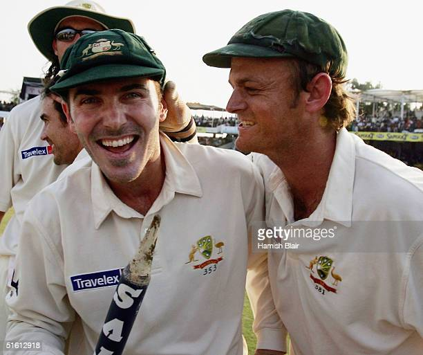Adam Gilchrist and Damien Martyn of Australia celebrate their teams win after day four of the Third Test between India and Australia played at the...