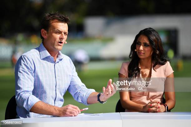 Adam Gilchrist and Isa Tara Guha commentate during day one of the First Test match in the series between Australia and India at Adelaide Oval on...
