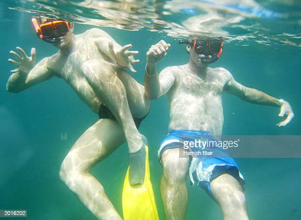 Adam Gilchrist and Jimmy Maher of Australia snorkel during a boat tour May 20 2003 in Castries St Lucia