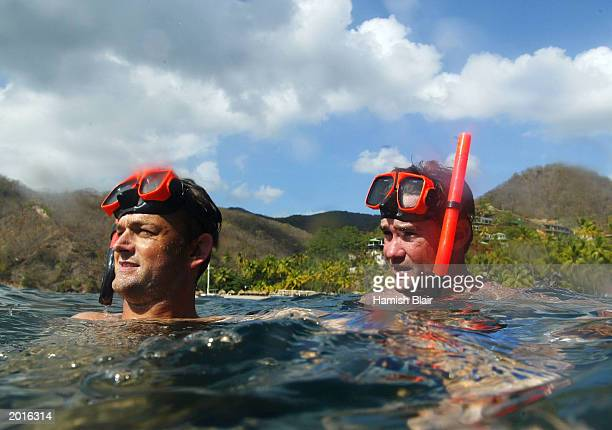 Adam Gilchrist and Jimmy Maher of Australia snorkel during a boat tour May 20 2003 Castries St Lucia