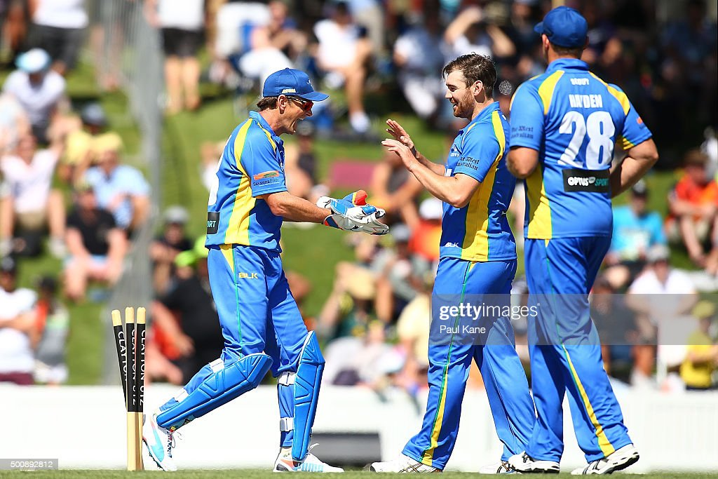 Adam Gilchrist and Ryan Duffield of the Legends celebrate a wicket during the WA Festival of Cricket Legends Match between the Australian Legends XI and Perth Scorchers at Aquinas College on December 11, 2015 in Perth, Australia.